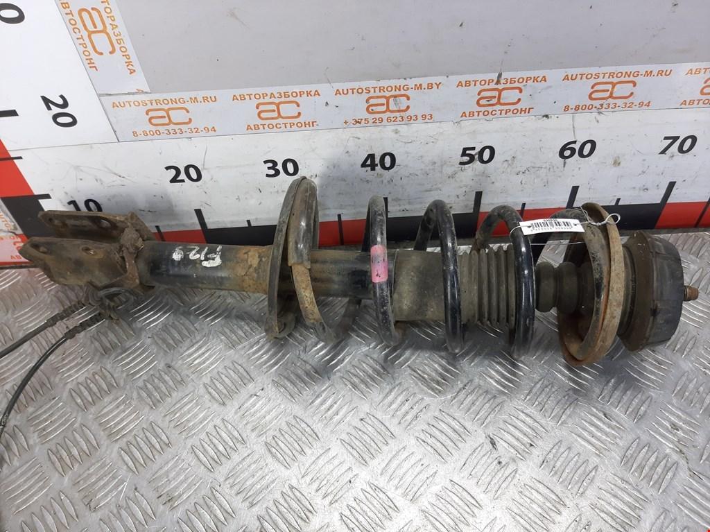 Стойка амортизатора переднего правого Dacia Sandero фото