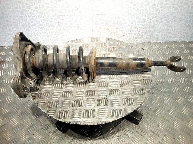 Стойка амортизатора переднего левого Volkswagen Passat 5 GP фото